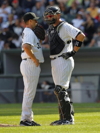 Jun 29, 2013; Chicago, IL, USA; Chicago White Sox starting pitcher Dylan Axelrod (33) talks with catcher Tyler Flowers (21) during the fifth inning against the Cleveland Indians at US Cellular Field. Cleveland won 4-3. Mandatory Credit: Dennis Wierzbicki-USA TODAY Sports