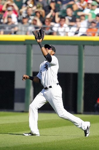 Jun 29, 2013; Chicago, IL, USA; Chicago White Sox right fielder Alex Rios (51) catches a fly ball off the bat of Cleveland Indians catcher Carlos Santana (not pictured) during the sixth inning at US Cellular Field. Cleveland won 4-3. Mandatory Credit: Dennis Wierzbicki-USA TODAY Sports