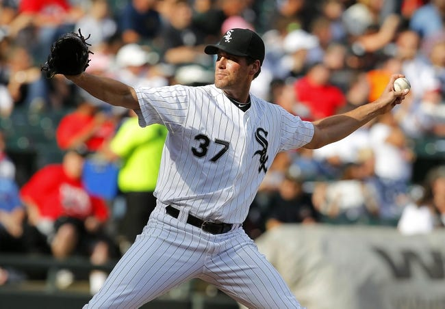 Jun 29, 2013; Chicago, IL, USA; Chicago White Sox relief pitcher Matt Thornton (37) delivers a pitch during the seventh inning against the Cleveland Indians at US Cellular Field. Cleveland won 4-3. Mandatory Credit: Dennis Wierzbicki-USA TODAY Sports