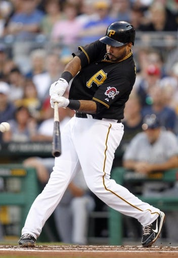 Jun 29, 2013; Pittsburgh, PA, USA; Pittsburgh Pirates third baseman Pedro Alvarez (24) hits a solo home run against the Milwaukee Brewers during the second inning at PNC Park. Mandatory Credit: Charles LeClaire-USA TODAY Sports