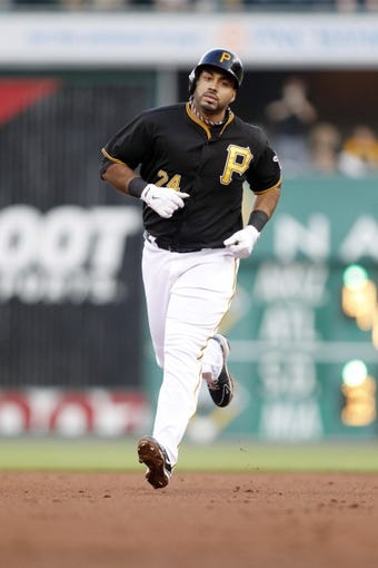 Jun 29, 2013; Pittsburgh, PA, USA; Pittsburgh Pirates third baseman Pedro Alvarez (24) rounds the bases after hitting a solo home run against the Milwaukee Brewers during the second inning at PNC Park. Mandatory Credit: Charles LeClaire-USA TODAY Sports