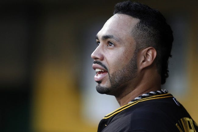 Jun 29, 2013; Pittsburgh, PA, USA; Pittsburgh Pirates third baseman Pedro Alvarez (24) reacts in the dugout while watching a replay of his solo home run against the Milwaukee Brewers during the second inning at PNC Park. Mandatory Credit: Charles LeClaire-USA TODAY Sports