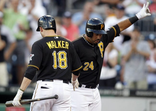 Jun 29, 2013; Pittsburgh, PA, USA; Pittsburgh Pirates second baseman Neil Walker (18) greets third baseman Pedro Alvarez (24) at home after Alvarez hit a solo home run against the Milwaukee Brewers during the second inning at PNC Park. Mandatory Credit: Charles LeClaire-USA TODAY Sports
