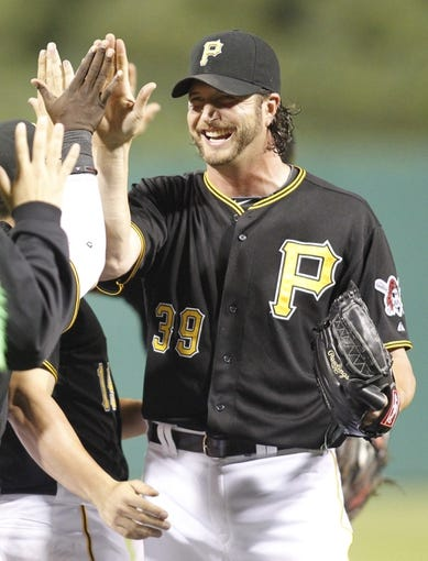 Jun 29, 2013; Pittsburgh, PA, USA; Pittsburgh Pirates relief pitcher Jason Grilli (39) high-fives his teammates after earning a save in the defeat of the Milwaukee Brewers at PNC Park. The Pittsburgh Pirates won 2-1. Mandatory Credit: Charles LeClaire-USA TODAY Sports