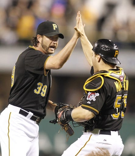 Jun 29, 2013; Pittsburgh, PA, USA; Pittsburgh Pirates relief pitcher Jason Grilli (39) high-fives Pittsburgh Pirates catcher Russell Martin (55) after defeating the Milwaukee Brewers at PNC Park. The Pittsburgh Pirates won 2-1. Mandatory Credit: Charles LeClaire-USA TODAY Sports