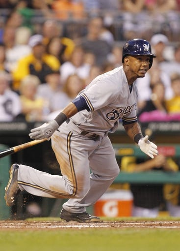 Jun 29, 2013; Pittsburgh, PA, USA; Milwaukee Brewers shortstop Jean Segura (9) at bat against the Pittsburgh Pirates during the sixth inning at PNC Park. The Pittsburgh Pirates won 2-1. Mandatory Credit: Charles LeClaire-USA TODAY Sports