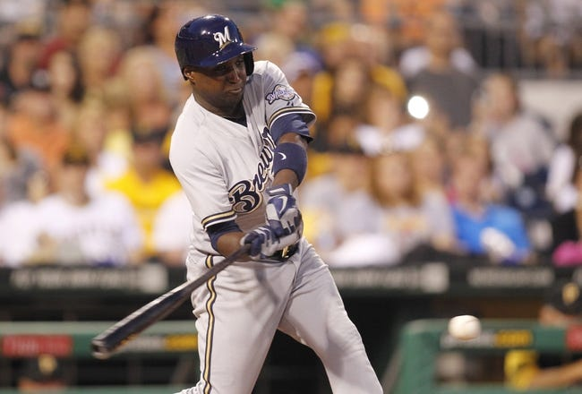 Jun 29, 2013; Pittsburgh, PA, USA; Milwaukee Brewers first baseman Yuniesky Betancourt (3) hits an RBI single against the Pittsburgh Pirates during the sixth inning at PNC Park. The Pittsburgh Pirates won 2-1. Mandatory Credit: Charles LeClaire-USA TODAY Sports