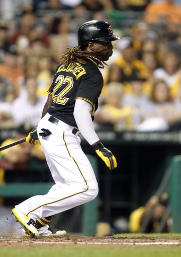 Jun 29, 2013; Pittsburgh, PA, USA; Pittsburgh Pirates center fielder Andrew McCutchen (22) singles against the Milwaukee Brewers during the sixth inning at PNC Park. The Pittsburgh Pirates won 2-1. Mandatory Credit: Charles LeClaire-USA TODAY Sports