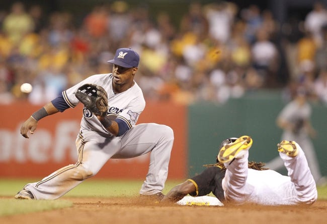 Jun 29, 2013; Pittsburgh, PA, USA; Milwaukee Brewers shortstop Jean Segura (9) takes a throw as Pittsburgh Pirates center fielder Andrew McCutchen (right) steals second base during the sixth inning at PNC Park. The Pittsburgh Pirates won 2-1. Mandatory Credit: Charles LeClaire-USA TODAY Sports