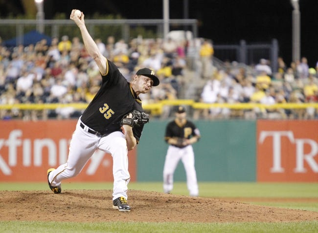 Jun 29, 2013; Pittsburgh, PA, USA; Pittsburgh Pirates relief pitcher Mark Melancon (35) pitches against the Milwaukee Brewers during the eighth inning at PNC Park. The Pittsburgh Pirates won 2-1. Mandatory Credit: Charles LeClaire-USA TODAY Sports
