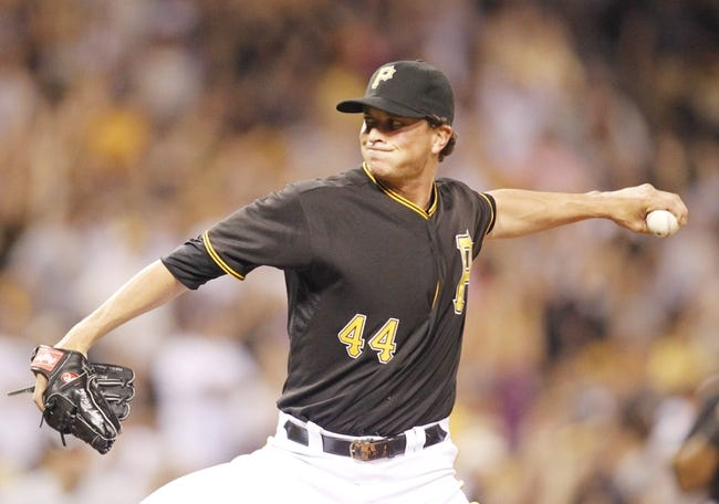 Jun 29, 2013; Pittsburgh, PA, USA; Pittsburgh Pirates relief pitcher Tony Watson (44) delivers a pitch against the Milwaukee Brewers during the seventh inning at PNC Park. The Pittsburgh Pirates won 2-1. Mandatory Credit: Charles LeClaire-USA TODAY Sports