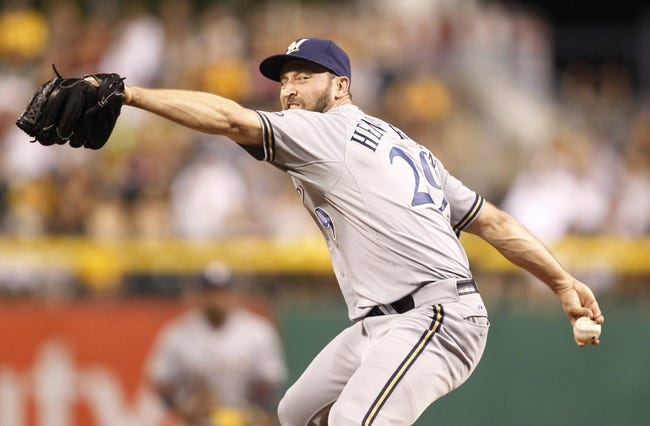 Jun 29, 2013; Pittsburgh, PA, USA; Milwaukee Brewers relief pitcher Jim Henderson (29) pitches against the Pittsburgh Pirates during the eighth inning at PNC Park. The Pittsburgh Pirates won 2-1. Mandatory Credit: Charles LeClaire-USA TODAY Sports