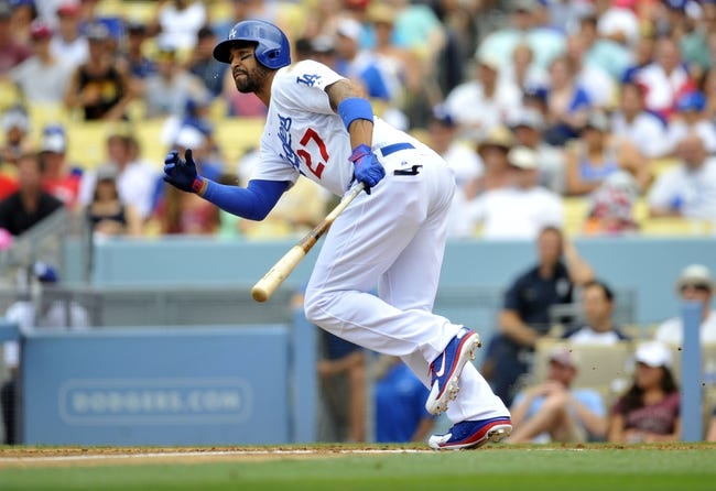 June 30, 2013; Los Angeles, CA, USA; Los Angeles Dodgers center fielder Matt Kemp (27) hits an RBI single in the third inning against the Philadelphia Phillies at Dodger Stadium. Mandatory Credit: Gary A. Vasquez-USA TODAY Sports