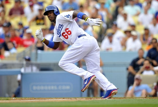 June 30, 2013; Los Angeles, CA, USA; Los Angeles Dodgers right fielder Yasiel Puig (66) runs after hitting a single during the third inning against the Philadelphia Phillies at Dodger Stadium. Mandatory Credit: Gary A. Vasquez-USA TODAY Sports