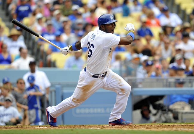 June 30, 2013; Los Angeles, CA, USA; Los Angeles Dodgers right fielder Yasiel Puig (66) hits a double during the seventh inning against the Philadelphia Phillies at Dodger Stadium. Mandatory Credit: Gary A. Vasquez-USA TODAY Sports