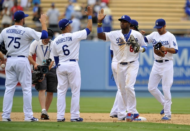 June 30, 2013; Los Angeles, CA, USA; Los Angeles Dodgers right fielder Yasiel Puig (66) and the Dodgers celebrate the 6-1 victory against the Philadelphia Phillies at Dodger Stadium. Mandatory Credit: Gary A. Vasquez-USA TODAY Sports