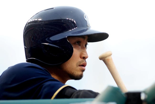 Jul 1, 2013; Washington, DC, USA; Milwaukee Brewers outfielder Norichika Aoki (7) waits on deck during the game against the Washington Nationals at Nationals Park. Mandatory Credit: Evan Habeeb-USA TODAY Sports