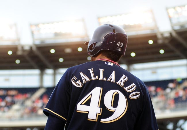 Jul 1, 2013; Washington, DC, USA; Milwaukee Brewers pitcher Yovani Gallardo (49) walks to the plate during the game against the Washington Nationals at Nationals Park. Mandatory Credit: Evan Habeeb-USA TODAY Sports