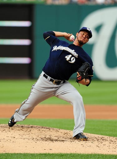 Jul 1, 2013; Washington, DC, USA; Milwaukee Brewers pitcher Yovani Gallardo (49) throws a pitch during the game against the Washington Nationals at Nationals Park. Mandatory Credit: Evan Habeeb-USA TODAY Sports