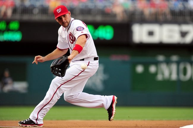 Jul 1, 2013; Washington, DC, USA; Washington Nationals third baseman Ryan Zimmerman (11) fields a ground ball in the third inning against the Milwaukee Brewers at Nationals Park. Mandatory Credit: Evan Habeeb-USA TODAY Sports