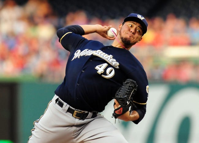 Jul 1, 2013; Washington, DC, USA; Milwaukee Brewers pitcher Yovani Gallardo (49) throws a pitch during the third inning against the Washington Nationals at Nationals Park. Mandatory Credit: Evan Habeeb-USA TODAY Sports