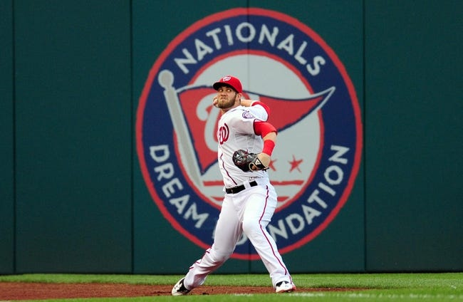 Jul 1, 2013; Washington, DC, USA; Washington Nationals outfielder Bryce Harper (34) throws the ball during the third inning against the Milwaukee Brewers at Nationals Park. Mandatory Credit: Evan Habeeb-USA TODAY Sports