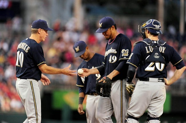 Jul 1, 2013; Washington, DC, USA; Milwaukee Brewers manager Ron Roenicke (10) takes the ball from pitcher Yovani Gallardo (49) as he is removed from the game in the fourth inning against the Washington Nationals at Nationals Park. Mandatory Credit: Evan Habeeb-USA TODAY Sports