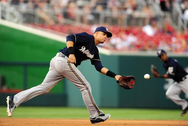 Jul 1, 2013; Washington, DC, USA; Milwaukee Brewers third baseman Aramis Ramirez (16) fields a ground ball during the third inning against the Washington Nationals at Nationals Park. Mandatory Credit: Evan Habeeb-USA TODAY Sports
