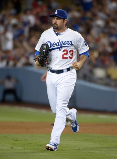 Jun 29, 2013; Los Angeles, CA, USA; Los Angeles Dodgers first baseman Adrian Gonzalez (23) against the Philadelphia Phillies at Dodger Stadium. The Dodgers defeated the Phillies 4-3. Mandatory Credit: Kirby Lee-USA TODAY Sports