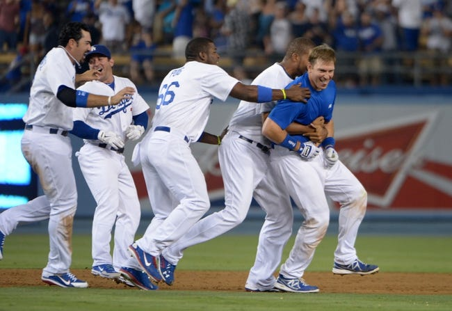 Jun 29, 2013; Los Angeles, CA, USA; Los Angeles Dodgers catcher A.J. Ellis (right) celebrates with teammates Yasiel Puig (66), Andre Ethier (16), Nick Punto (7), Mark Ellis (14), Kenley Jansen (74  and Matt Kemp (27) after hitting a walk-off single in the ninth inning against the Philadelphia Phillies at Dodger Stadium. The Dodgers defeated the Phillies 4-3. Mandatory Credit: Kirby Lee-USA TODAY Sports
