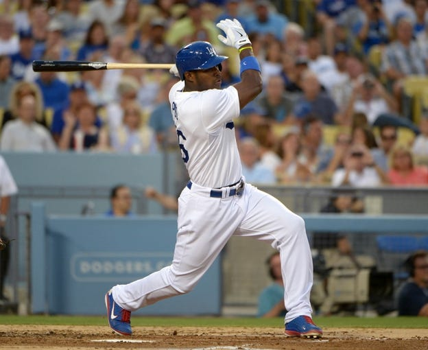 Jun 29, 2013; Los Angeles, CA, USA; Los Angeles Dodgers right fielder Yasiel Puig (66) bats against the Philadelphia Phillies at Dodger Stadium. The Dodgers defeated the Phillies 4-3. Mandatory Credit: Kirby Lee-USA TODAY Sports
