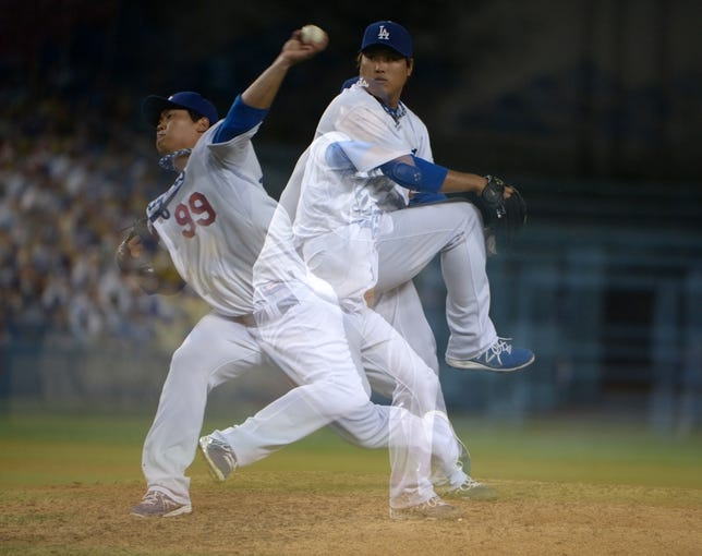 Jun 29, 2013; Los Angeles, CA, USA; Multiple exposure of Los Angeles Dodgers pitcher Hyun-Jin Ryu (99) against the Philadelphia Phillies at Dodger Stadium. The Dodgers defeated the Phillies 4-3. Mandatory Credit: Kirby Lee-USA TODAY Sports