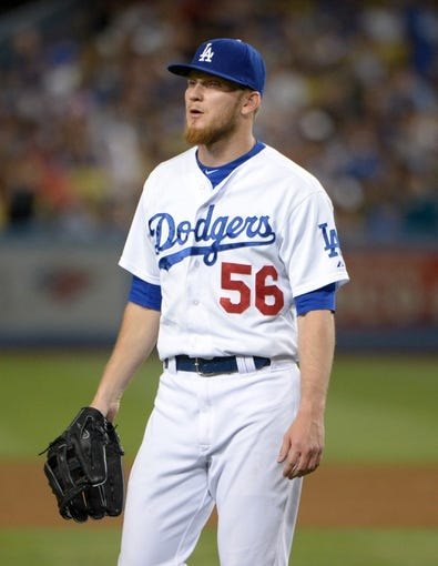 Jun 29, 2013; Los Angeles, CA, USA; Los Angeles Dodgers pitcher J.P. Howell (56) during the game against the Philadelphia Phillies at Dodger Stadium. The Dodgers defeated the Phillies 4-3. Mandatory Credit: Kirby Lee-USA TODAY Sports