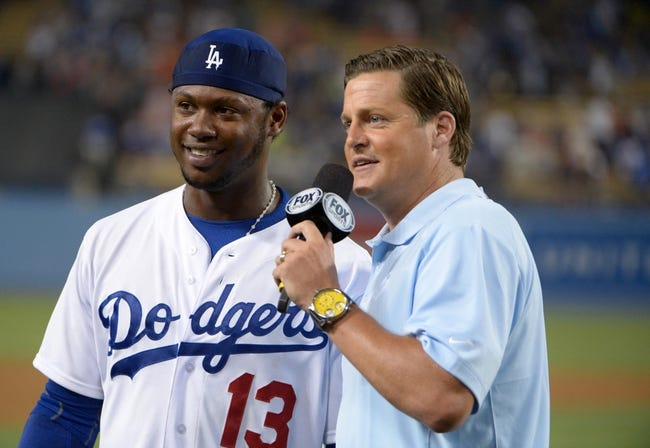 Jun 29, 2013; Los Angeles, CA, USA; Los Angeles Dodgers shortstop Hanley Ramirez (13) is interviewed by Fox Sports reporter Mark Rogondino after the game against the Philadelphia Phillies at Dodger Stadium. The Dodgers defeated the Phillies 4-3. Mandatory Credit: Kirby Lee-USA TODAY Sports