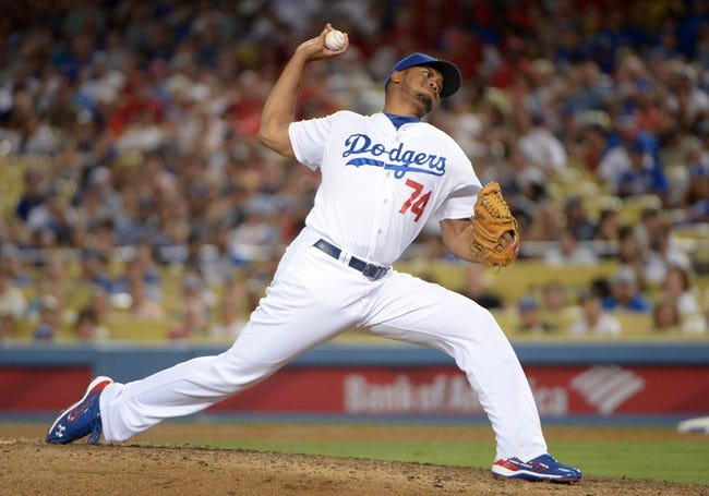 Jun 29, 2013; Los Angeles, CA, USA; Los Angeles Dodgers reliever Kenley Jansen (74) delivers a pitch in the ninth inning against the Philadelphia Phillies at Dodger Stadium. The Dodgers defeated the Phillies 4-3. Mandatory Credit: Kirby Lee-USA TODAY Sports