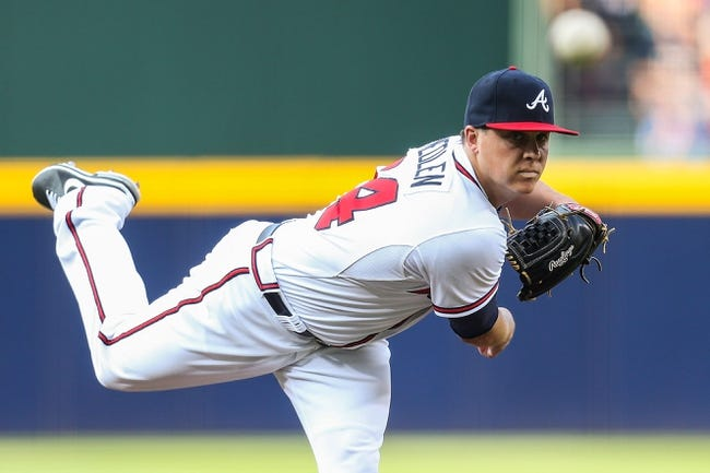 Jul 2, 2013; Atlanta, GA, USA; Atlanta Braves starting pitcher Kris Medlen (54) pitches in the first inning against the Miami Marlins at Turner Field. Mandatory Credit: Daniel Shirey-USA TODAY Sports