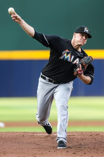 Jul 2, 2013; Atlanta, GA, USA; Miami Marlins starting pitcher Tom Koehler (34) pitches in the first inning against the Atlanta Braves at Turner Field. Mandatory Credit: Daniel Shirey-USA TODAY Sports
