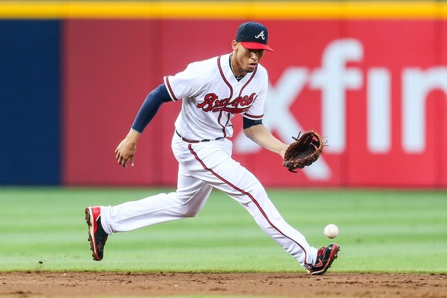 Jul 2, 2013; Atlanta, GA, USA; Atlanta Braves shortstop Andrelton Simmons (19) fields a ground ball in the second inning against the Miami Marlins at Turner Field. Mandatory Credit: Daniel Shirey-USA TODAY Sports
