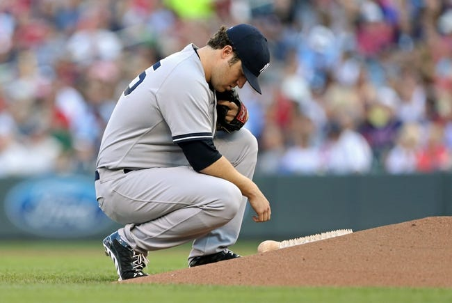 Jul 2, 2013; Minneapolis, MN, USA; New York Yankees starting pitcher Phil Hughes (65) kneels down before throwing a first pitch against the Minnesota Twins at Target Field. Mandatory Credit: Jesse Johnson-USA TODAY Sports