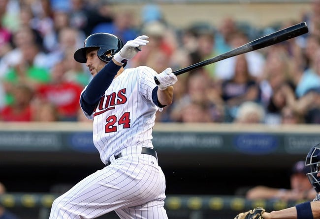 Jul 2, 2013; Minneapolis, MN, USA; Minnesota Twins third baseman Trevor Plouffe (24) hits a single in the second inning against the New York Yankees at Target Field. Mandatory Credit: Jesse Johnson-USA TODAY Sports