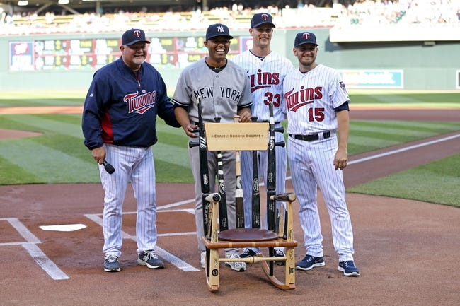 Jul 2, 2013; Minneapolis, MN, USA; Minnesota Twins relief pitcher Glen Perkins (15), first baseman Justin Morneau (33) and manager Ron Gardenhire present a rocking chair to New York Yankees relief pitcher Mariano Rivera (42) before the game at Target Field. Mandatory Credit: Jesse Johnson-USA TODAY Sports