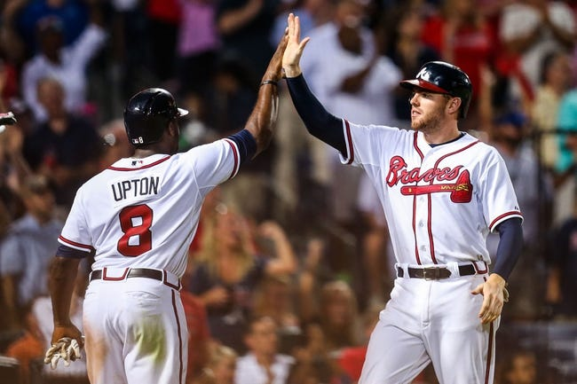 Jul 2, 2013; Atlanta, GA, USA; Atlanta Braves left fielder Justin Upton (8) and first baseman Freddie Freeman (5) celebrate after scoring in the sixth inning against the Miami Marlins at Turner Field. Mandatory Credit: Daniel Shirey-USA TODAY Sports