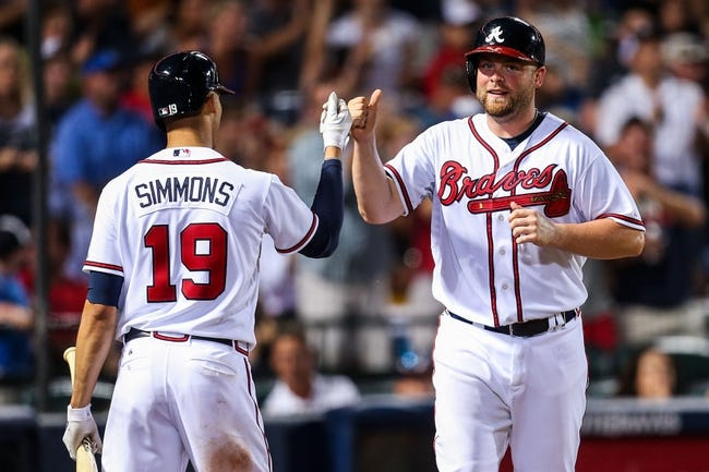 Jul 2, 2013; Atlanta, GA, USA; Atlanta Braves catcher Brian McCann (16) celebrates with shortstop Andrelton Simmons (19) after scoring in the sixth inning against the Miami Marlins at Turner Field. Mandatory Credit: Daniel Shirey-USA TODAY Sports