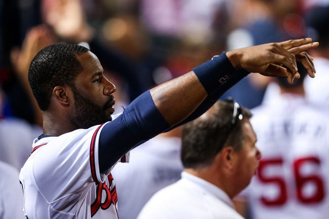 Jul 2, 2013; Atlanta, GA, USA; Atlanta Braves right fielder Jason Heyward (22) celebrates after a third baseman Chris Johnson (not pictured) double in the sixth inning against the Miami Marlins at Turner Field. Mandatory Credit: Daniel Shirey-USA TODAY Sports