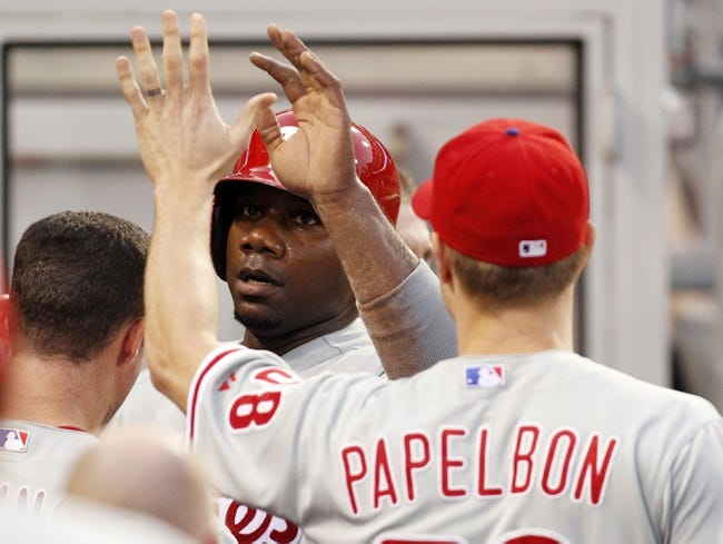 Jul 2, 2013; Pittsburgh, PA, USA; Philadelphia Phillies relief pitcher Jonathan Papelbon (58) greets first baseman Ryan Howard (left) in the dugout after Howard scored a run against the Pittsburgh Pirates during the sixth inning at PNC Park. Mandatory Credit: Charles LeClaire-USA TODAY Sports