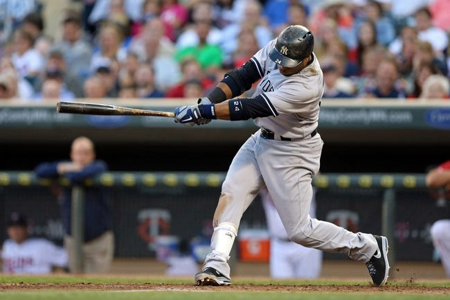 Jul 2, 2013; Minneapolis, MN, USA; New York Yankees second baseman Robinson Cano (24) hits a single in the fourth inning against the Minnesota Twins at Target Field. Mandatory Credit: Jesse Johnson-USA TODAY Sports
