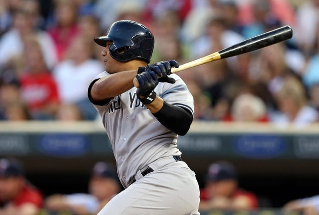 Jul 2, 2013; Minneapolis, MN, USA; New York Yankees shortstop Alberto Gonzalez (40) hits a two run double in the fifth inning against the Minnesota Twins at Target Field. Mandatory Credit: Jesse Johnson-USA TODAY Sports