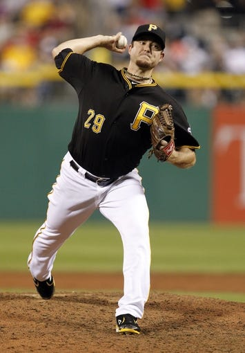 Jul 2, 2013; Pittsburgh, PA, USA; Pittsburgh Pirates relief pitcher Bryan Morris (29) pitches against the Philadelphia Phillies during the ninth inning at PNC Park. The Philadelphia Phillies won 3-1. Mandatory Credit: Charles LeClaire-USA TODAY Sports