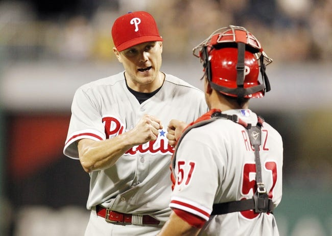 Jul 2, 2013; Pittsburgh, PA, USA; Philadelphia Phillies relief pitcher Jonathan Papelbon (58) and Phillies catcher Carlos Ruiz (51) celebrate after defeating the Pittsburgh Pirates during the ninth inning at PNC Park. The Philadelphia Phillies won 3-1. Mandatory Credit: Charles LeClaire-USA TODAY Sports
