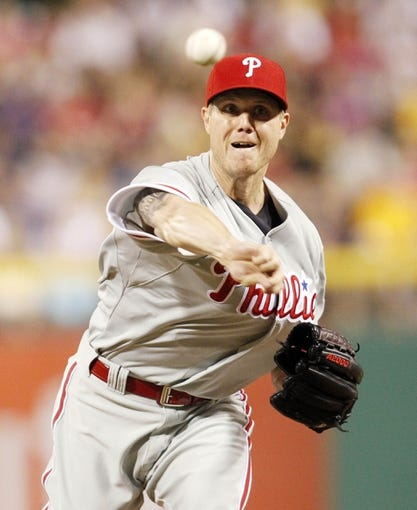 Jul 2, 2013; Pittsburgh, PA, USA; Philadelphia Phillies relief pitcher Jonathan Papelbon (58) pitches against the Pittsburgh Pirates during the ninth inning at PNC Park. The Philadelphia Phillies won 3-1. Mandatory Credit: Charles LeClaire-USA TODAY Sports